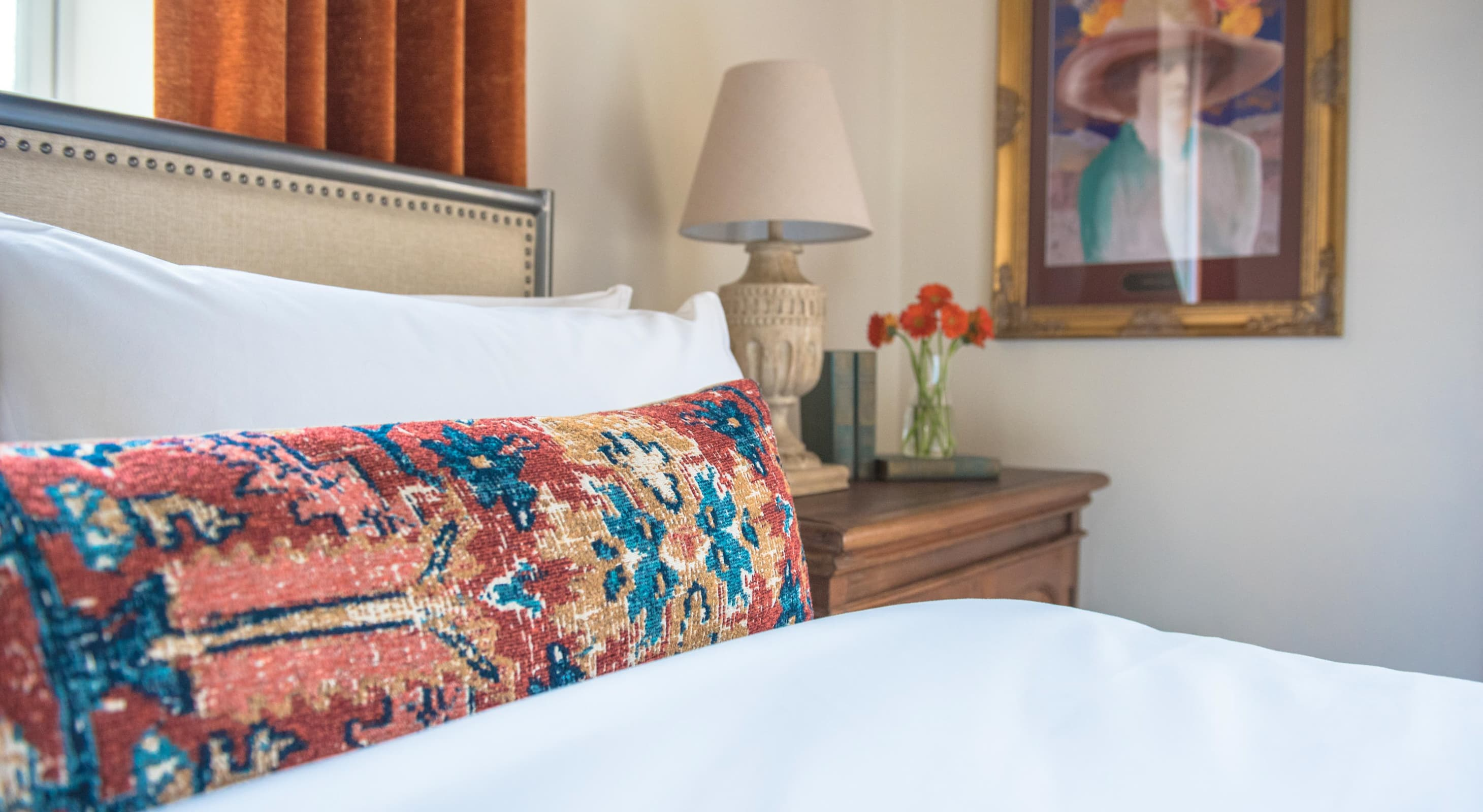 Greenway room bed with colorful pillows