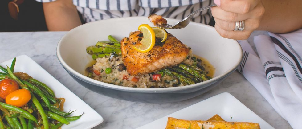 Grilled salmon served with asparagus on a bed of fried rice